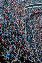 A sports stadium filled to capacity for Christ crusade crowd of people group worship outreach the gospel