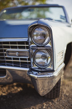 Close up on a the headlights of a classic car