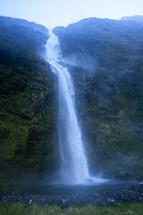 A beautiful waterfall pouring down a mountainside