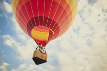 A couple riding in a hot air balloon