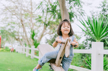 toddler girl on a seesaw