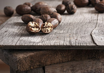 Pecans on a rustic plywood table.