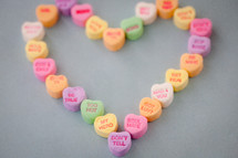 candy conversation hearts in the shape of a heart for Valentine's day