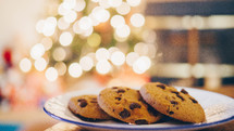 plate of cookies in front of a Christmas tree