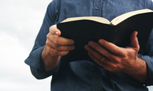 a man reading a Bible