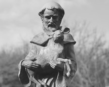 Statue of Saint Francis holding a deer