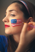 woman face pairing a flag for July 4th