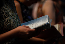 parishioners holding Bibles during a worship service