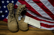 Holy Bible, American flag, boots, and military dog tags
