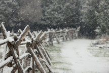 snow on a fence line