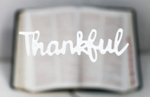 word thankful over an open Bible
