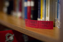 raffle tickets on a library  bookshelf