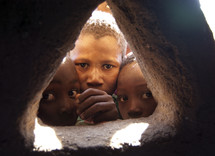 children peaking through a window