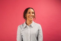 head shot of a smiling woman in a button down shirt