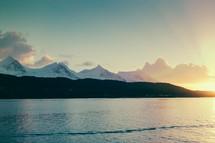 shore, sunset, ocean, water, snow, mountain peaks, mountains, outdoors, sky