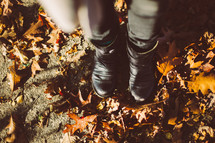boots standing in fall leaves