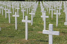 Simple cross grave markers in a war grave yard