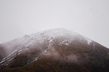fog over snow capped mountains