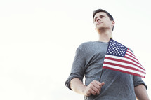 Man holding an American flag.
