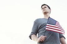 Man holding an American flag.