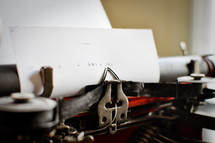 "An antique typewriter and paper that reads ""i love you."""