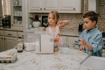 kids baking cookies in a kitchen