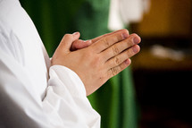 praying hands of a priest