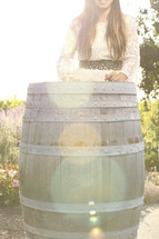 Happy woman by wood barrel