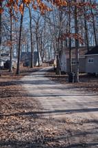 dirt road between homes