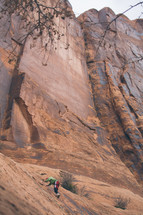 a man rock climbing on a steep cliff
