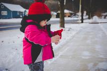 toddler girl in the snow