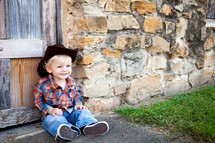 Toddler in cowboy hat outdoors