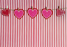 hearts banner and striped background