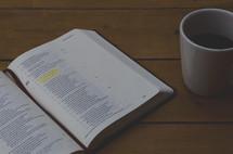 open Bible and coffee mug