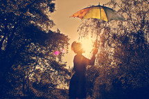woman holding up an umbrella to block the sunlight