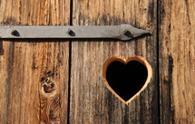 heart shape carved into wood door
