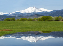 reflection of a snow capped volcanic mountain
