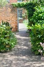 brick path through a garden