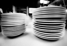 stacked white plates in a restaurant