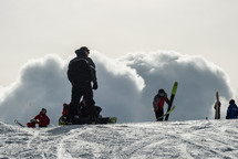 skiers at the top of a slope