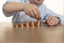a boy child counting money