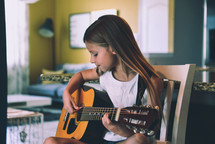 a girl playing a guitar