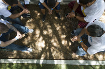 Group in circle praying