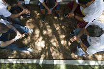 Group in circle praying
