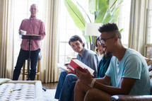man leading a group Bible study discussing scripture