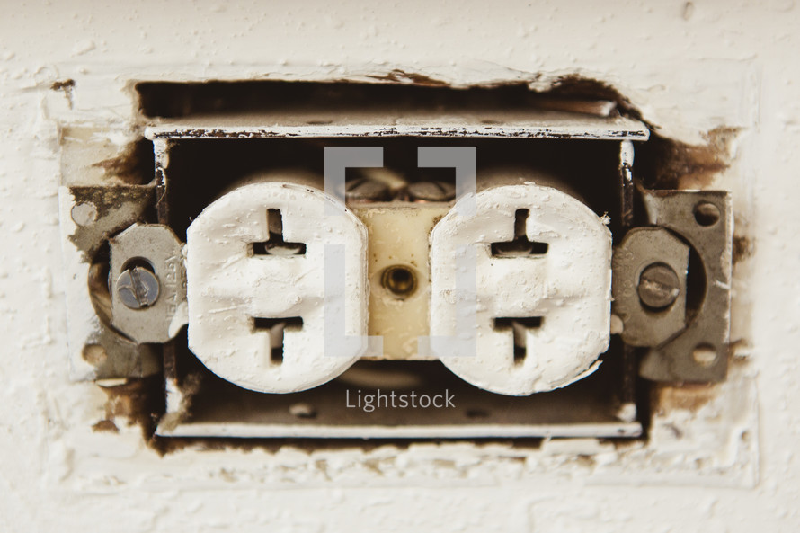 Electrical outlet in wall.