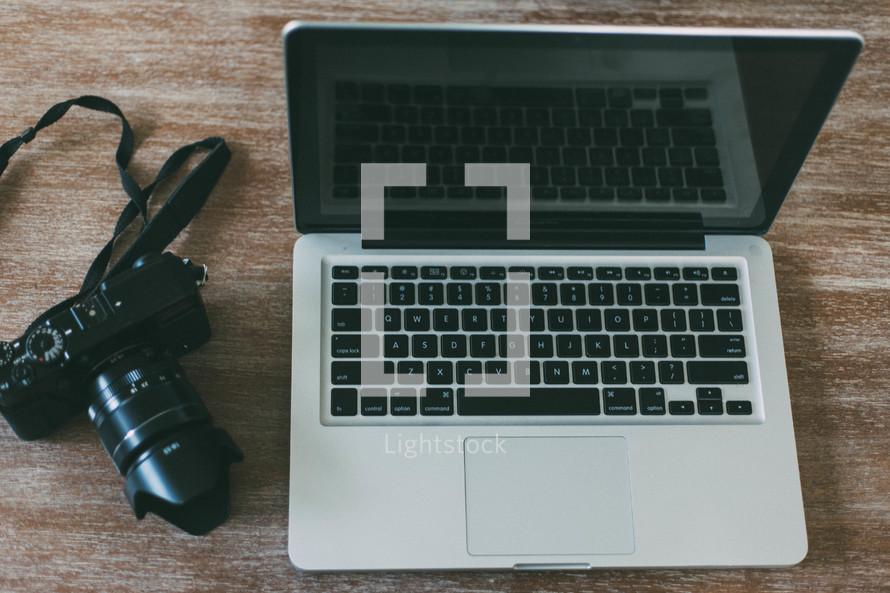 camera beside a laptop