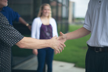 welcoming hand shakes by church greeters