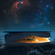 A woman in a large book reads by flashlight under a night sky
