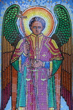 Tile mosaic of an angel holding scales
